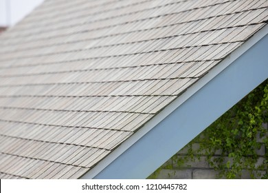 edge of Roof shingles on top of the house, dark asphalt tiles on the roof