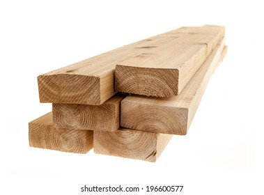 Edge of six cedar two by four wood boards on white background