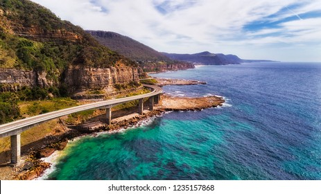 Edge of steep sandscone cliffs along Australian pacific coast with scenic Grand Pacific drive route via Sea Cliff bridge.