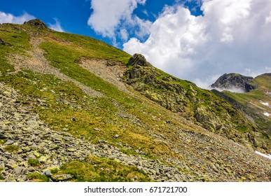 edge of steep slope on rocky hillside in cloudy weather. dramatic scenery in mountains