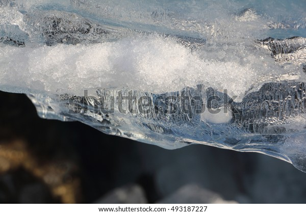 Edge of the thawing ice  on the river in the spring