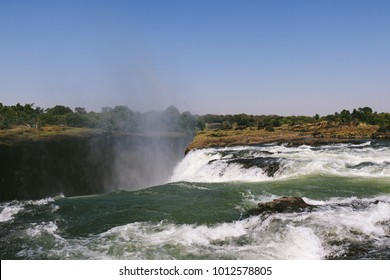 "The edge of Victoria Falls in Zimbabwe, near Livingstone Island and the naturally formed ""Devil's Pool"", where tourists can swim near the edge in the dry season"