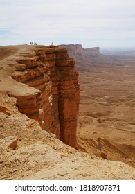 Edge of the world, the towering cliffs jut dramatically from the middle of a barren desert.