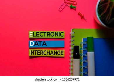 EDI. Electronic Data Interchange acronym on sticky notes. Office desk background