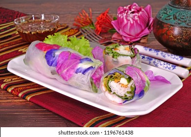 Edible flowers : Edible flowers spring rolls. Beautiful and delicious Thai cuisine. Colorful appitizers made from edible flowers, shrimps, rice noodle and organic vegetables wrapped with rice paper