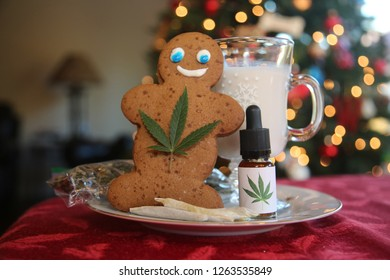 Edible Marijuana. Gingerbread man. Santa Claus gift of Edibles and Marijuana Products. Marijuana Christmas. Ginger Bread Man with Cannabis Leaf. Cannabis Infused Gingerbread Man. Recreational pot.