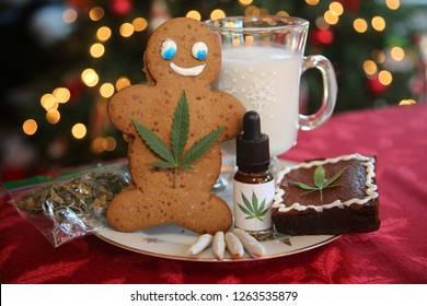 Edible Marijuana. Gingerbread man. Santa Claus gift of Edibles and Marijuana Products. Marijuana Christmas. Ginger Bread Man with Cannabis Leaf. Cannabis Infused Gingerbread Man. Recreational pot.