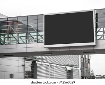 E-Digital big large empty blank screen big Billboard TV mockup template for advertisement on the top of modern building at convention center hall, expo, airport, shopping center, parking.