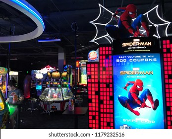Edina, MN/USA- August 22, 2018. The interior of a Dave and Buster's, featuring a new Spiderman Homecoming game in their arcade area.