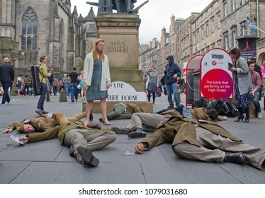 EDINBURGH: AUGUST 2: Cast of The Picture House musical play dead on the Royal Mile, the main street of Edinburgh, at the Edinburgh Festival Fringe on August 2, 2012 in Edinburgh, UK.