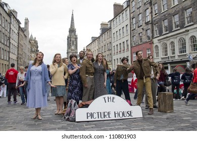 EDINBURGH AUGUST 2: Cast of The Picture House musical of Play Pen Productions sing on the Royal Mile, the main street of Edinburgh, at the Edinburgh Festival Fringe on August 2, 2012 in Edinburgh.