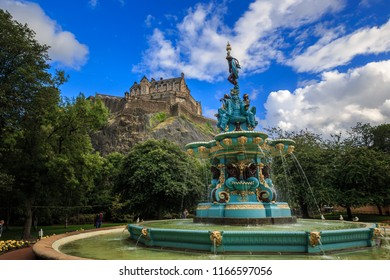 Edinburgh Castle in blue sky and clouds and Ross Fountain