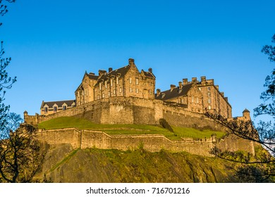 Edinburgh Castle is a historic fortress which dominates the skyline of the city of Edinburgh, Scotland, from its position on the Castle Rock. T