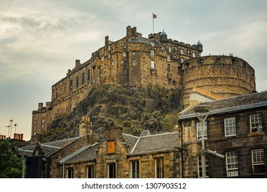 Edinburgh Castle on a cloudy day from street below