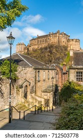 Edinburgh Castle on top of the rock taken from the Vennel off of Grassmarket, Edinburgh, Scotland, on a sunny summers day, showing the Victorian lamps lining the street