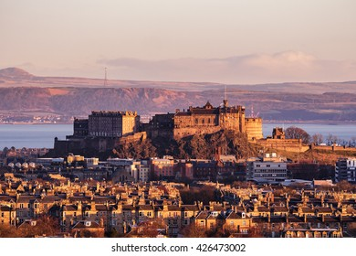 The Edinburgh Castle Rock  at Sunrise with the Firth of Forth at the back. Scotland, UK