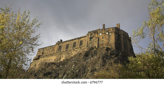 Edinburgh Castle In Scotland (as seen from The Grassmarket area of the city)