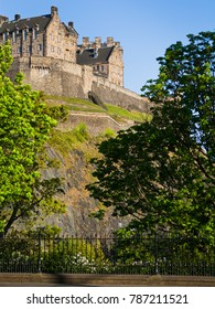 Edinburgh Castle in Scotland during spring with fresh green leaves.