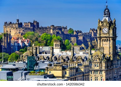 Edinburgh Castle as it sits on the rock above the city and the Balmoral Clock in the foreground.