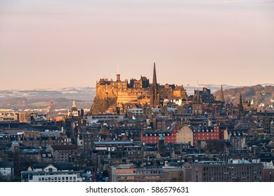 Edinburgh Castle at sunrise with the UNESCO Heritage recognized old town in the foreground. Edinburgh, Scotland, United Kingdom