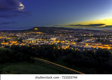 Edinburgh city from Arthur's seat in a beautiful sky and moon