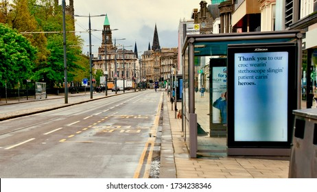 Edinburgh City centre with empty streets and roads during lockdown. Bus stops advertising boards  thanking medical staff during covid 19 lockdown. Princes street edinburgh Scotland UK. may 2020