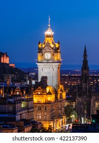 Edinburgh cityscape at night with Balmoral Clock in the foreground and the Sir Walter Scott Monument at the background, Scotland, UK