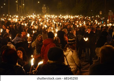 EDINBURGH - DECEMBER 30: people take part in a torchlight procession on December 30, 2010 in Edinburgh, Scotland. The torchlight procession is an annual event to celebrate the end of the year.