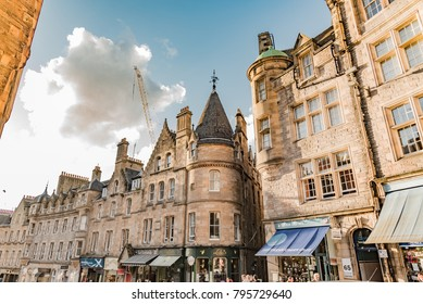 Edinburgh, England - August 15, 2017: alleys and streets of the capital of Scotland Edinburgh in summer with traffic and its gloomy gray stone buildings