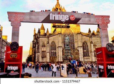 Edinburgh Festival Fringe banner, sponsored by Virgin Money, on the Royal Mile with St Giles Cathedral in the background.  Annual arts festival in Edinburgh city. Scotland UK. August 2018