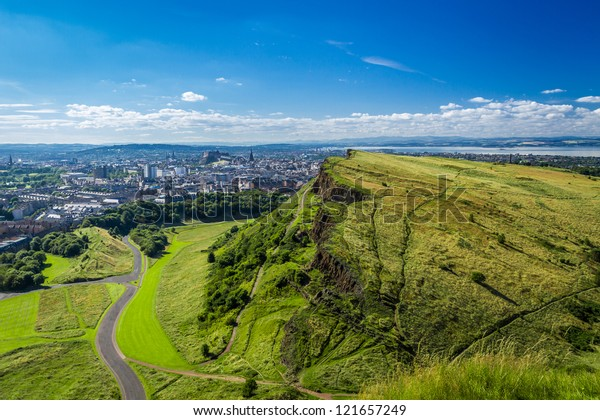 Edinburgh and green hills in summer