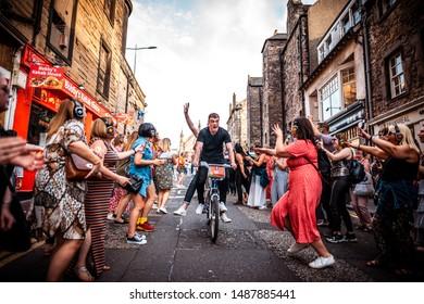 Edinburgh, Lothians / Scotland - 08/24/19: Just Eat Bike cycling through Silent Disco at the Edinburgh Fringe 2019. Down from Greyfiars Bobby to Cowgate/Grassmarket.