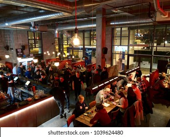 EDINBURGH - MARCH 3, 2018: Customers eat and drink inside Brewdog Lothian Road craft beer bar in Edinburgh, Scotland, UK.
