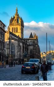 Edinburgh, Midlothian, Scotland - February 4 2020: St Giles Cathedral on the Royal Mile in Edinburgh lit by the morning sunrise