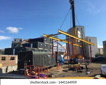 Edinburgh, Midlothian /UK - July 03 2019 : New Modular Homes being pre built and lifted into place by Mobile Crane leaving only Plumbing and Electric to be connected and a Brick Shell Covering.