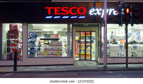 """EDINBURGH - OCTOBER 27: the exterior of a Tesco Express store on October 27, 2012 in Edinburgh, UK. On December 5, 2012, Tesco announced closure of up to 200 stores in the US branded """"Fresh & Easy""""."""