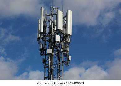 EDINBURGH, SCOTLAND - 03 March 2020 Mobile Phone Mast on Blue Sky and Cloud Background