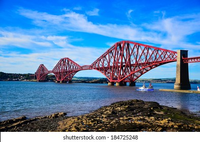EDINBURGH, SCOTLAND - 18 JULY 2013: The Forth Bridge, a cantilever railway bridge over the Firth of Forth in the east of Scotland, 9 miles (14 kilometres) west of central Edinburgh.