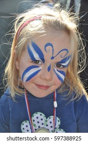 Edinburgh, Scotland 22 September 2012 - First Scottish Independence referendum march from the Meadows to Princes street gardens - child with Saltire butterfly facepaint