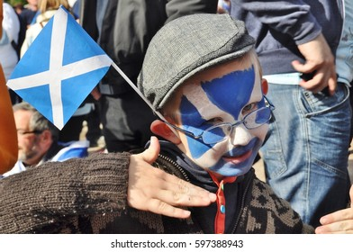 Edinburgh, Scotland 22 September 2012 - First Scottish Independence referendum march from the Meadows to Princes street gardens - child with Saltire and facepaint