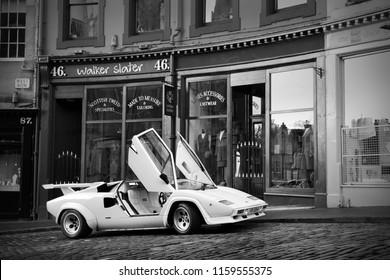 Edinburgh, Scotland - 27/10/2013: A vintage Lamborghini Countach QV parking in an old Edinburgh street, with its doors open in the air.