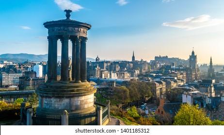 Edinburgh, Scotland - 28th April 2019: View of Dugald Stewart monument in front of Edinburgh city center. Spring 2019