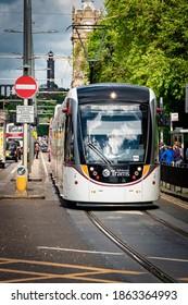 Edinburgh, Scotland, 30th May 2017: One of Edinburghs now famous trams makes its way west along Princes Street