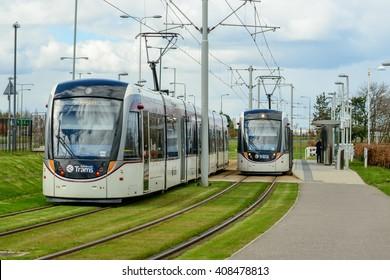 EDINBURGH, SCOTLAND  APRIL 16, 2016: Two Edinburgh tramcars at Gyle Centre station to the west of the city.