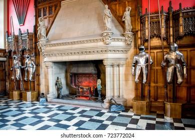 Edinburgh, Scotland, April 2016: Knights armor and a large fireplace inside of Great Hall in Edinburgh Castle