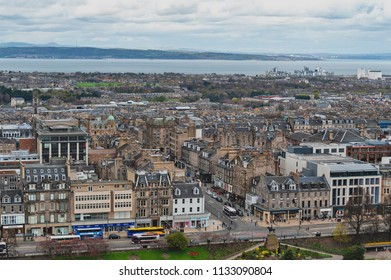 Edinburgh, Scotland - April 2018: Cityscape of old town Edinburgh with classic Scottish buildings on Princess Street towards North Sea as seen from the Esplanade of Edinburgh Castle