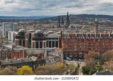 Edinburgh, Scotland - April 2018: Cityscape of old town Edinburgh from Princess Street Gardens towards the University of Edinburgh, Charlotte Chapel, and Saint Mary Cathedral