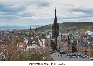 Edinburgh, Scotland - April 2018: Cityscape of Old Town Edinburgh on Royal Mile in Scotland with Tron Kirk, former gothic church, now functioned as The Hub, a venue for various events and festivals