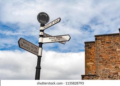 Edinburgh, Scotland - April 2018: Direction signpost inside Edinburgh Castle, popular tourist attraction and landmark of Edinburgh, capital city of Scotland, UK