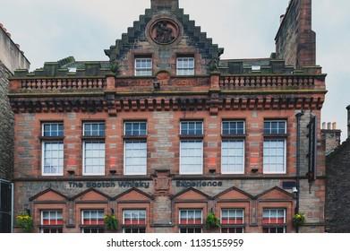 Edinburgh, Scotland - April 2018: Front facade of The Scotch Whiskey Experience on Royal Mile, touristic street of Old Town Edinburgh City in Scotland, UK